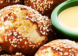 Pretzel Rolls with Cheesy Mustard Dipping Sauce